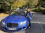 id:2739 : 2018-10-30/thumbs/my_wife_and_our_bentley_gtd_speed_at_sdhloss_berg_on_lake_starnberg.jpg